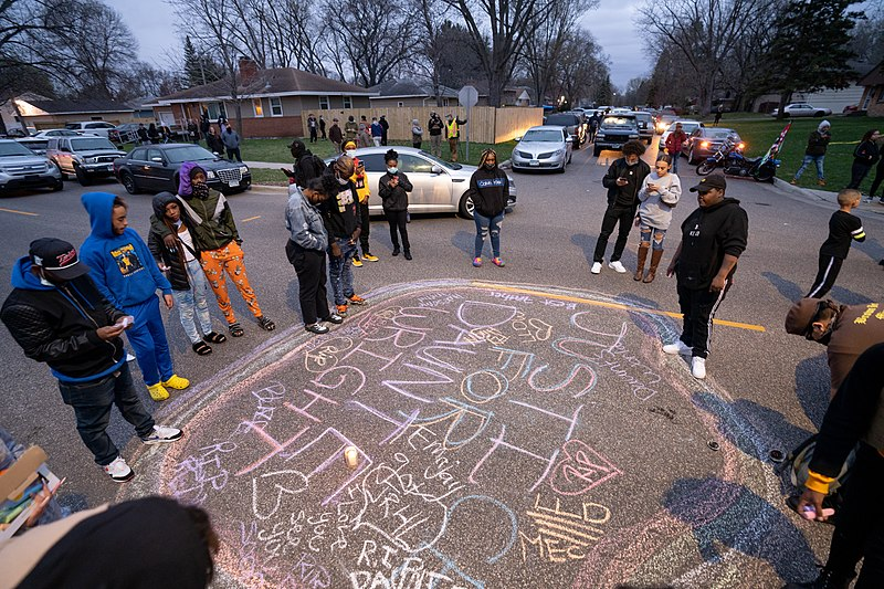 Black community members mourn Daunte Wright with a candlelight and chalk drawing vigil in Brooklyn Center, Minneapolis